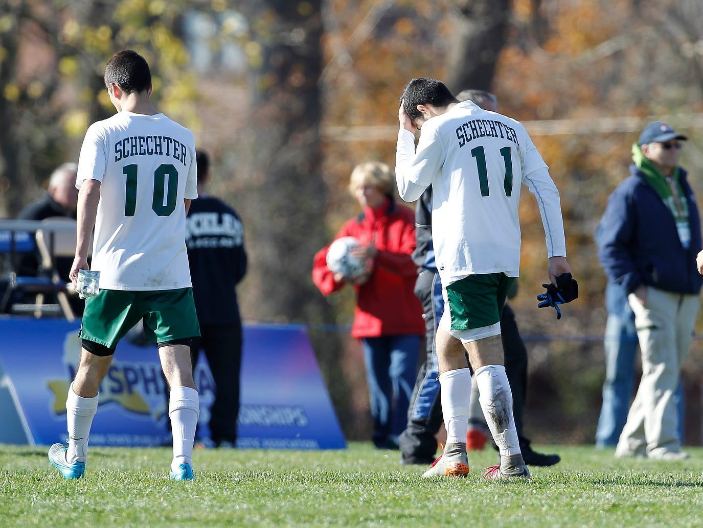 Solomon Schechter's Daniel Kohen (10), Jonathan Rand (11) and Jonathan Tolchinsky (7) walk off the field after their 9-1 loss to Notre Dame in the NYSPHSAA boys class C soccer final at Middletown High School on Sunday, Nov. 15, 2015.
