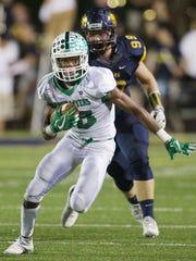 Fort Myers High School's John Coleus scores a touchdown