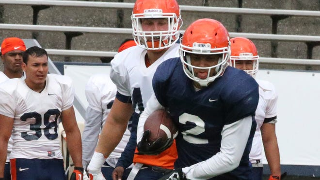 UTEP running back Terry Juniel, 2, takes off with the ball during a scrimmage Aug. 27 in Sun Bowl Stadium.