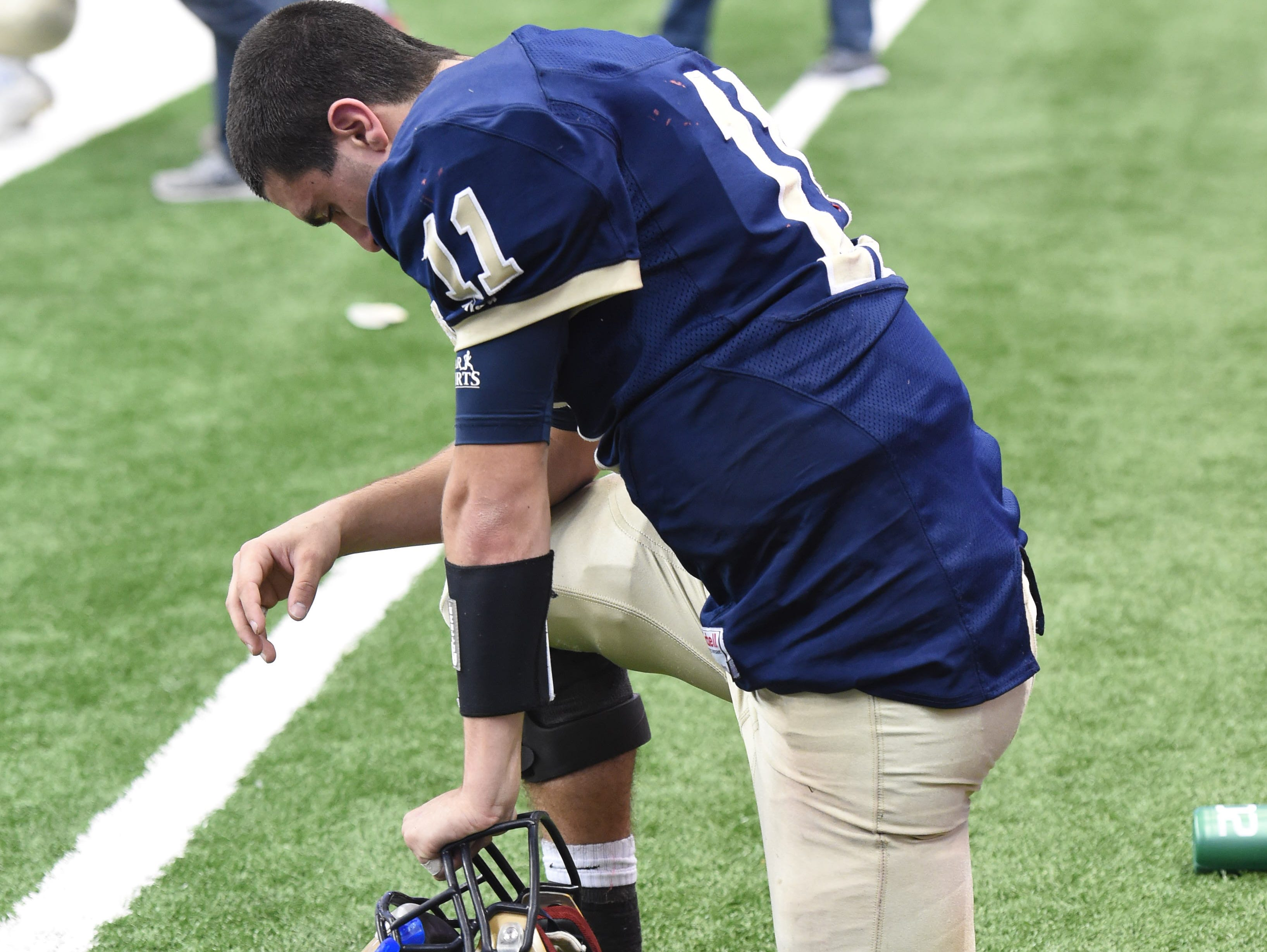 Lourdes' Dean Rotger hangs his head after the New York State Championship final versus South Park in Syracuse on Friday.