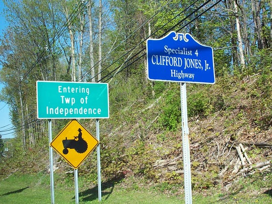 sign post for the Clifford Jones Jr. Highway on Route
