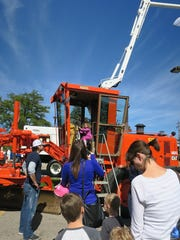 Kids line up to get a chance to sit in a heavy-duty