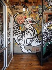Hand-painted wall art at Gogi Seoul Kitchen, opening