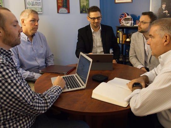 A Mason Digital team meeting includes Chris Markham,