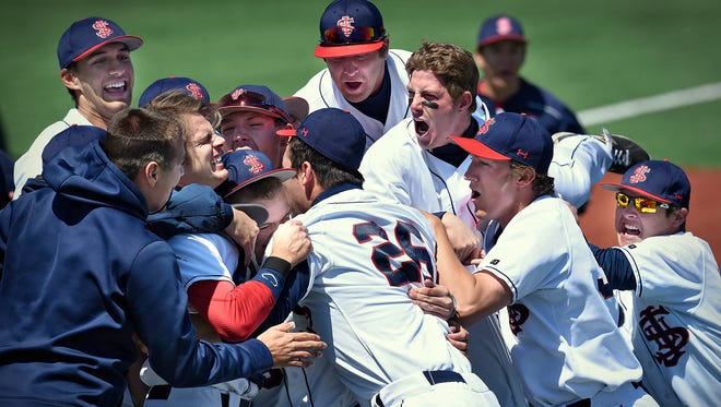 St. John's university players celebrate at the end of Saturday's MIAC conference championship game at Becker Park in Collegeville. With the win St. John's earned an automatic bid to the NCAA Tournament on May 27-31.