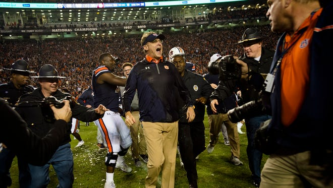 Auburn head coach Gus Malzahn reacts to being dunked after the Iron Bowl NCAA football game between Auburn and Alabama on Saturday, Nov. 25, 2017, in Auburn, Ala. Auburn defeated Alabama 26-14.