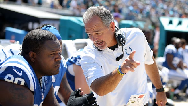 Indianapolis Colts head coach Chuck Pagano talks with Cory Redding in the second half.