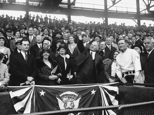 President Herbert Hoover throws out the ceremonial