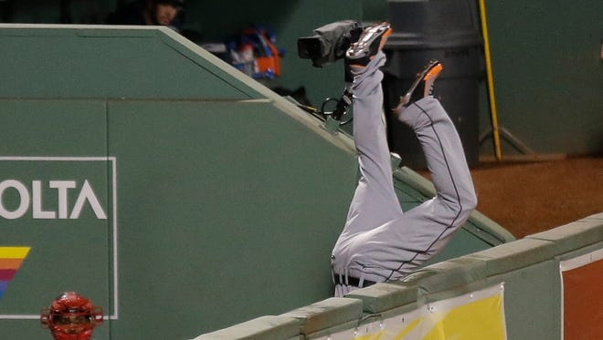 Torii Hunter leaps and misses a catch as David Ortiz hits a grand slam home run in the eighth inning.