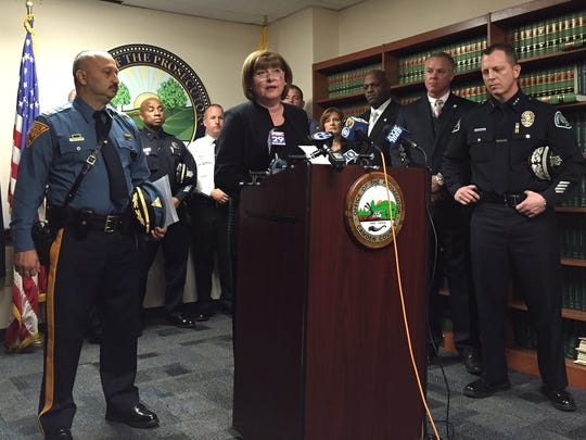 Camden County Prosecutor Mary Eva Colalillo is flanked by law enforcement as she announces drug-network arrests.