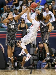 MSU freshman Nick Ward blocks the shot of Arizona's Keanu Pinder during the first half of the Armed Forces Classic Friday in Honolulu.