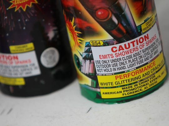 Caution labels printed on legal fireworks offer safety tips about what to expect from the firework and safe ways to ignite it. Photographed on Thursday, June 26, 2014 during a firework safety presentation by Cathedral City Fire Department.