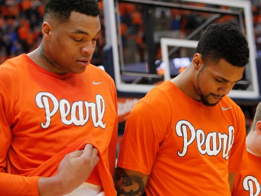 """Dajuan Coleman, left, and Michael Gbinije, right, wear shirts in support of Syracuse basketball great Dwayne """"Pearl"""" Washington, who died Wednesday, April 20, 2016 of brain cancer."""