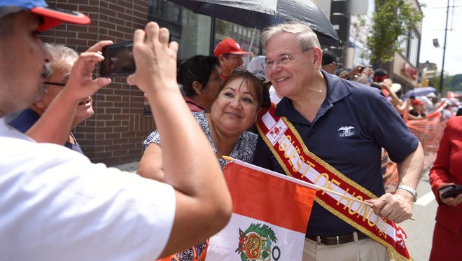The 32nd annual Peruvian Day Parade was held on Sunday, July 29, 2018. The parade begins on Main Street in Passaic, and continues through Clifton and into downtown Paterson. Senator Robert Menendez poses for a pictures with a parade attendee along the route in Paterson. Senator Robert Menendez poses for a picture along the parade route in Paterson.