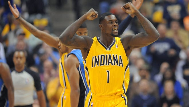Pacers Lance Stephenson celebrates a play with the fans. Indiana Pacers play the Orlando Magic in their season opening game Tuesday, October 29, 2013, evening at Bankers Life Fieldhouse. Matt Kryger / The Star