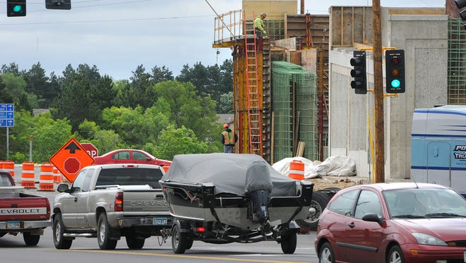 Crews work on a new section of U.S. Highway 10 in Rice on June 12.
