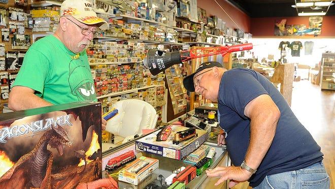 Lynn Schober, left, works with customer Dave Elder, Marshfield on some model train items Elder was purchasing at JadeCo Stamp & Hobby in Stevens Point.