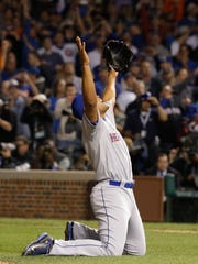 New York Mets' Jeurys Familia celebrates after Game 4 of the National League baseball championship series against the Chicago Cubs Wednesday, Oct. 21, 2015, in Chicago. The Mets won 8-3 to advance to the World Series. (AP Photo/Nam Y. Huh)