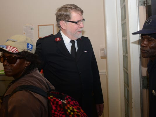ANI Salvation Army Thefts Salvation Army Maj. Ken Nelson (center) greets people as they enter the dining room of the Salvation Army building on Beauregard Street Thursday, Dec. 25, 2014 for Christmas dinner.-Melinda Martinez/mmartinez@thetowntalk.com
