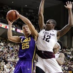 LSU's Ben Simmons (25) shoots as Texas A&M's Jalen Jones (12) defends during the second half of their game last month in College Station, Texas. Texas A&M won 71-57.