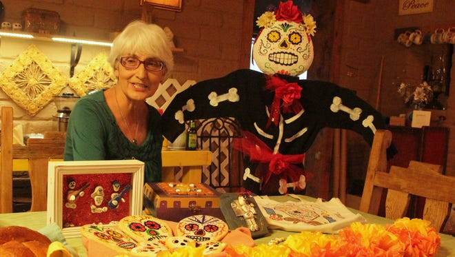 La Luz local Stephanie Yates has long celebrated Dia de los Muertos. This year Yates has organized a public altar, where anyone can bring mementos, at the Alamogordo Public Library. Yates feels it is important to share her Hispanic heritage openly and to help dispel myths about Dia de los Muertos.