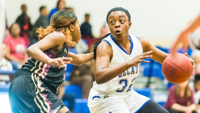 Stephen Decatur guard Dayona Godwin (32) drives to the basket against Hammond in the MPSSAA playoffs at Stephen Decatur High School on Monday, March 1.