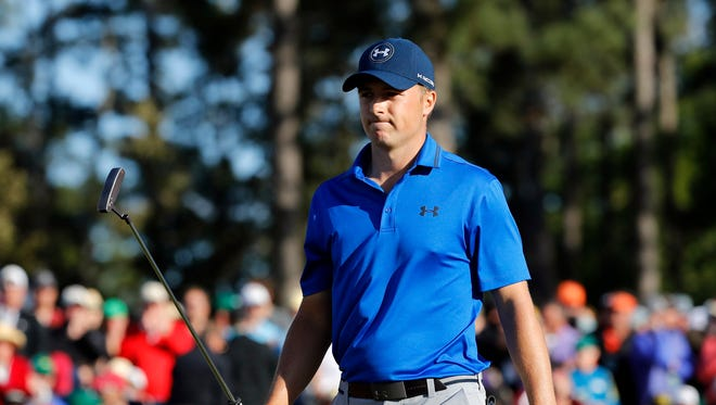 Jordan Spieth makes par on the 18th green during the second round of the 2016 The Masters golf tournament at Augusta National Golf Club.