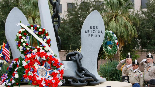 Pearl Harbour 162278 -- 12/7/2009 -- Wreaths are laid at the U.S.S. Arizona Anchor Memorial during Pearl Harbour Observance ceremomies at Wesley Bolin Plaza in Phoenix, AZ. (Photo by Rob Schumacher/The Arizona Republic)