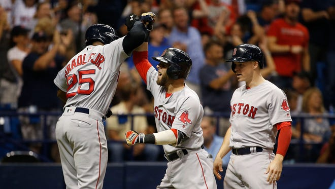 Dustin Pedroia is congratulated by Jackie Bradley Jr. after he hit a grand slam.