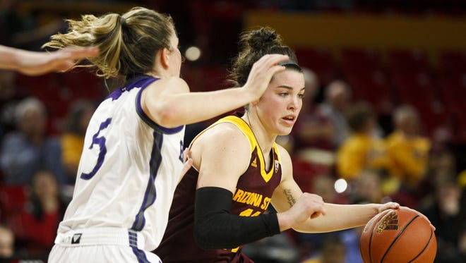ASU freshman guard Robbi Ryan (11) drives to the basket as Holy Cross junior guard Katie Doherty (5) defends in the second half at Wells Fargo Arena in Tempe on Wednesday, Dec. 21, 2016.