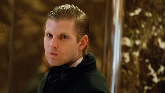 In this Dec. 15, 2016, file photo, Eric Trump, son of President-elect Donald Trump, waits for an elevator in the lobby of Trump Tower in New York.