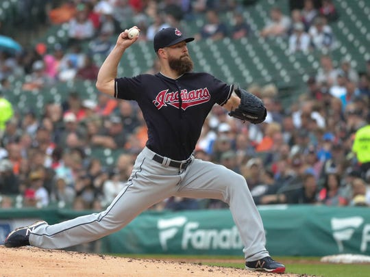Corey Kluber pitches during the third inning Sunday at Comerica Park.
