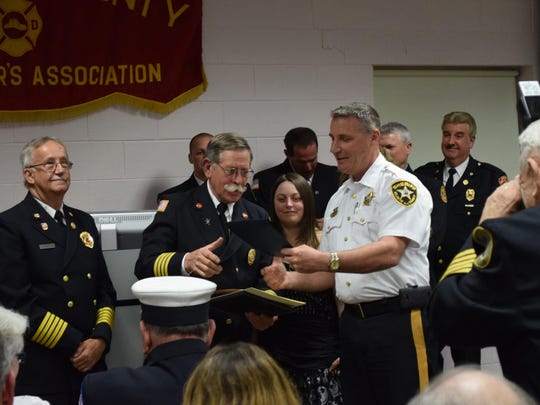 Donald L. Stauffer of Scullville Fire Company No. 3 receives an award from Atlantic County Sheriff Frank Balles in recognition of Stauffer's 50 years of service in the fire department.
