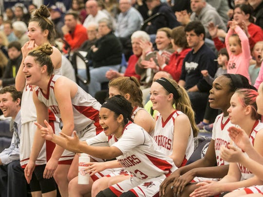 Susquehannock's Jayla Galbreath (23) and other teammates