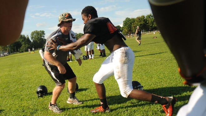 Former New Hanover and Jacksonville assistant coach Pat Byrd works with linebackers during a New Hanover practice in 2013. Byrd is in his first season as Richlands' coach.