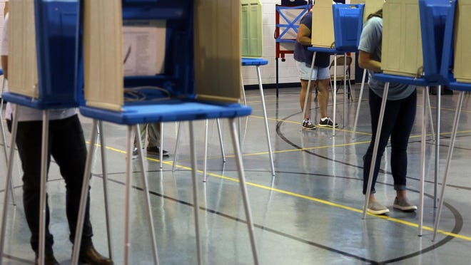 Voters fill booths at Mt. Zion Baptist Church in Kings Mountain on Wednesday.