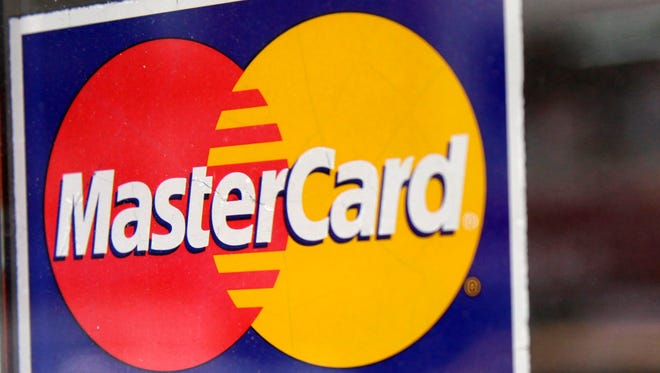 A window decal indicating that MasterCard is accepted at a New York business.