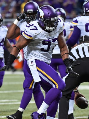 Everson Griffen celebrates a second-half sack during the Vikings' season-opening win.