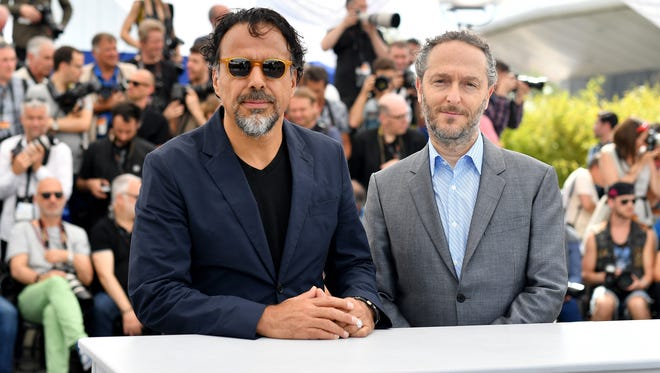 Alejandro Gonzalez Inarritu and 'Carne y Arena' cinematographer Emmanuel Lubezki attend a Cannes photocall.
