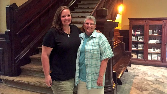 Jenifer Borke, left, and Sherry Harding were the first same-sex couple in Butler County to receive a marriage license Friday.
