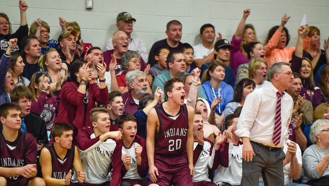 Fans in the crowd cheer when Southern Fulton scores during a boys basketball game in McConnellsburg, Pa. on Friday, Jan. 8, 2016. Southern Fulton beat McConnellsburg 40-27