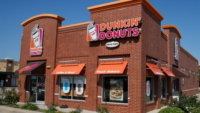 """FILE - This Thursday, July 28, 2016, file photo shows a Dunkin' Donuts in Edmond, Okla. Dunkin' is thinking about dumping """"Donuts"""" from its name. A new location in Pasadena, Calif., will be called simply Dunkin', a move that parent company Dunkin' Brands Inc. calls a test. The Canton, Mass.-based company says a few other stores will get the one-name treatment too."""