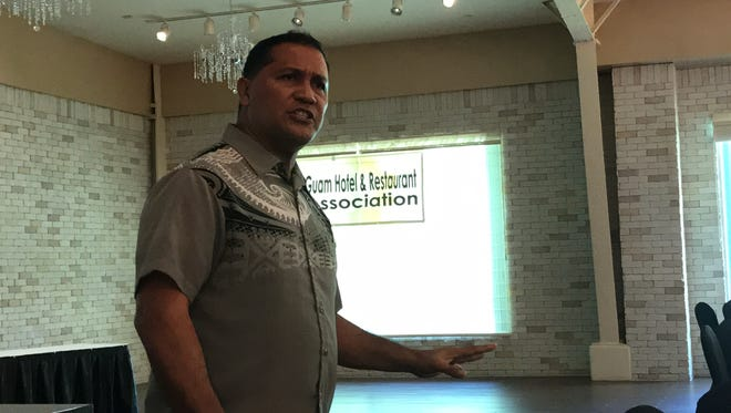 Roland Quitugua, extension association from the Guam Department of Agriculture, speaks to the Guam Hotel and Restaurant Association about the need to combat invasive species at the association's second quarter meeting, held  Thursday, May 18 at the Guam Plaza Hotel.