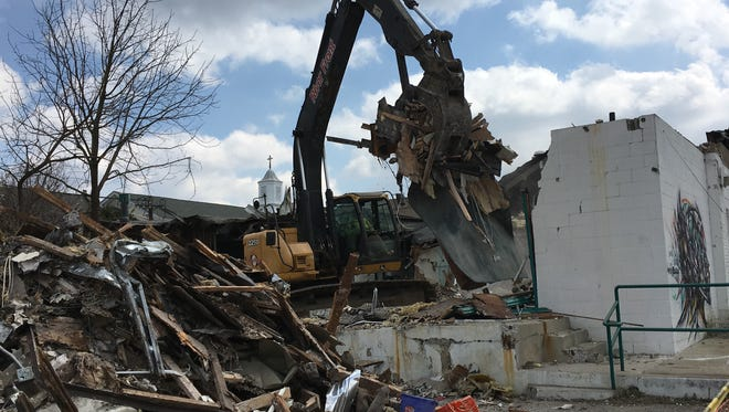 A long-empty fitness center on Broad Street in Woodbury comes down this week to make way for a redevelopment.