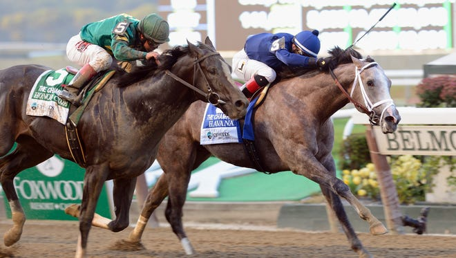 Honor Code, with Javier Castellano aboard, eft, finishes behind Havana in the Foxwoods Champagne Stakes at Belmont Park in October.