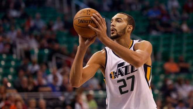 Utah Jazz's Rudy Gobert shoots a free throw during the first half of an NBA preseason basketball game against the Phoenix Suns.