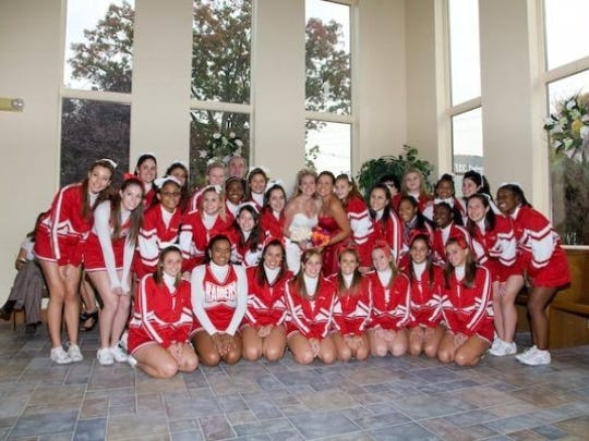 Lauren Bunyan Gould requested her varsity cheerleading squad be at her wedding — in full uniform.