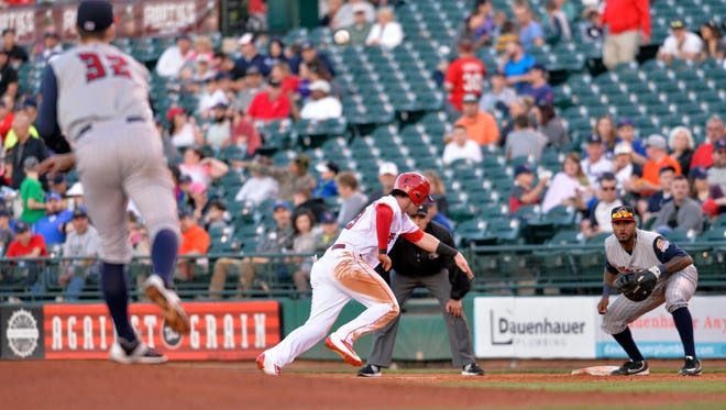 Louisville's Jesse Winker, center, attempts to beat the pickoff throw from Toledo's Thad Weber during their home opener at Louisville Slugger Field, Thursday, Apr. 14, 2016 in Louisville Ky.