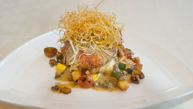Dean Corbett's parmesan-crusted halibut with lemon beurre blanc and fried leeks.