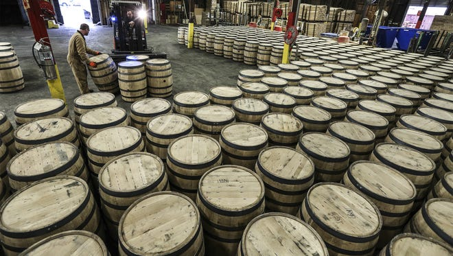 Jamie Ashley and Jamey Snyder load barrels into a truck on the loading dock at the Brown-Forman cooperage in Louisville. The facility is one of three company facilities listed as zero waste. The other is Jack Daniel in Tennessee and a tequila plant in Mexico.  February 7, 2017
